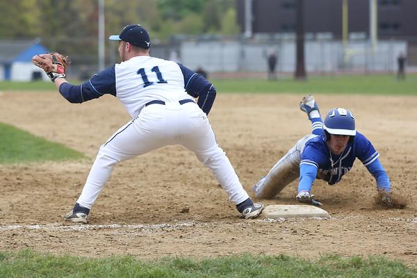 HADLEY GREEN/ Staff photo<br /> Peabody first baseman Jake Doherty (11) prepares to catch the ball at the Peabody v. Braintree boys varsity baseball game at Peabody Veterans Memorial High School. 5/13/17