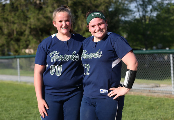 HADLEY GREEN/ Staff photo Essex Tech pitcher Sherri Fallon (30) stands next to catcher Alison Sholds (22) after the Danvers v. Essex Tech girls softball game at the Great Oak School in Danvers. 5/18/17