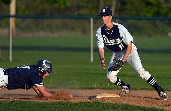 RYAN HUTTON/ Staff photo<br /> Swampscott's AJ Venuti tries to make it safely back to second as Danvers' Anthony Olszak moves to make the play in the top of the second inning of Wednesday's game at Danvers.