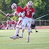 HADLEY GREEN/ Staff photo<br /> Masco's Bryan Gilbert (22) and Tommy Jung (5) celebrate after winning the seventh annual North Shore Cup. 5/24/17