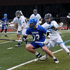 HADLEY GREEN/ Staff photo<br /> Danvers' Cole Johnson (23) moves toward the goal while Peabody's Stephen Ell (9) plays defense at the Peabody v. Danvers boys varsity lacrosse game at Peabody Memorial High School. 5/6/17