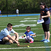 AMY SWEENEY/Staff photo. Dominic Colella, left, a volunteer from Danvers High School,  and volunteer Meghan Daly, help Crystal Guzman, with a game during the Annual Special Olympics Danvers Day Games at Danvers High School J. Ellison Morse Athletic Complex at Dr. Deering Stadium. The games are being held for all special needs children in the Danvers Public Schools grades K-12 and surrounding local communities.<br /> May 19, 2017