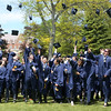 HADLEY GREEN/ Staff photo<br /> After the ceremony, students gathered outside to throw their caps in the air. 5/21/17