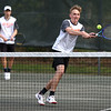 HADLEY GREEN/ Staff photo<br /> Ipswich's Jesse Cullen-Popp returns the ball while playing with teammate Noel Seigert at the Hamilton-Wenham v. Ipswich boys variety tennis match at Pingree park in Wenham. 5/11/17