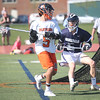 HADLEY GREEN/ Staff photo<br /> Beverly's Sam Abate (5) runs with the ball as Hamilton-Wenham's Bryson Cala (5) plays defense at the Beverly v. Hamilton-Wenham boys varsity lacrosse game at Beverly High School. 5/16/17