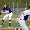 RYAN HUTTON/ Staff photo<br /> Swampscott pitcher Luke Marshall looks to throw to first as Danvers' Anthony Olszak speeds down the baseline in the bottom of the fifth inning of Wednesday's game at Danvers.