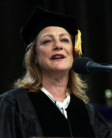HADLEY GREEN/ Staff photo<br /> Commencement speaker Rhonda Kallman, founder and CEO of Boston Harbor Distillery and co-founder of the Boston Beer Company, brewer of Samuel Adams, addresses graduates at the commencement ceremony. 5/25/17