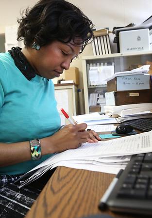 Salem elections supervisor Rochelle Sport checks the signatures for Salem sanctuary petition.