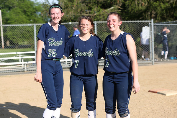 HADLEY GREEN/ Staff photo Essex Tech players Catie O'Shea (25), Ali Vienneau (7) and Emily Brown (27) pose after the Danvers v. Essex Tech girls softball game at the Great Oak School in Danvers. 5/18/17