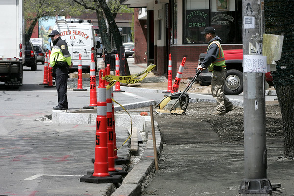 City DPW crews are working on extending the curb along Cabot Street where it intersects with Winter and Knowlton streets