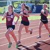 HADLEY GREEN/ Staff photo<br /> From left, Gloucester's Holly Fossa and Maura McCormack and Beverly's Lexi Setyak run the girls two mile race at the NEC track championships at Peabody High School. 5/20/17