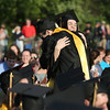 HADLEY GREEN/ Staff photo<br /> Cassidy Woods and Derek Dellisola hug after winning the Bishop Benedict Joseph Fenwick Award at Bishop Fenwick's graduation. 5/19/17
