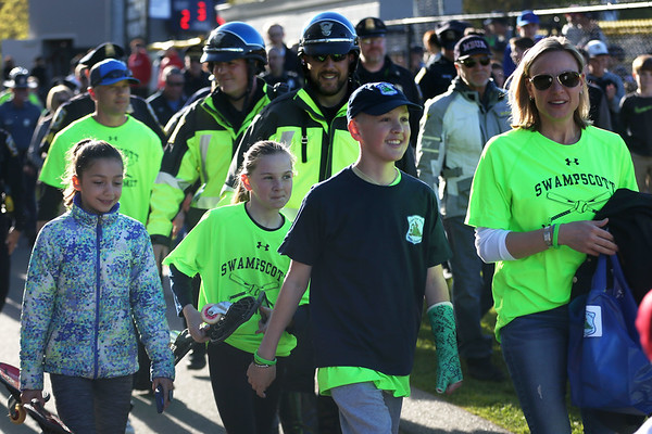 HADLEY GREEN/ Staff photo<br /> Nathan DeRoche, 13, of Swampscott, is escorted onto the Swampscott Middle School baseball field by local police and his family. The community event and fundraiser was planned for DeRoche, who is battling cancer, at the Swampscott v. Masco baseball game. 5/12/17