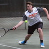 HADLEY GREEN/ Staff photo<br /> Ipswich's Nico Roessler returns the ball during a doubles match at the Hamilton-Wenham v. Ipswich boys varsity tennis match at Pingree park in Wenham. 5/11/17