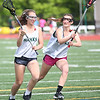 HADLEY GREEN/ Staff photo<br /> Libby Grayson runs towards the net while Meaghan Paine defends her during a drill at the Essex Tech girls lacrosse practice at Essex Technical High School in Danvers. 5/24/17