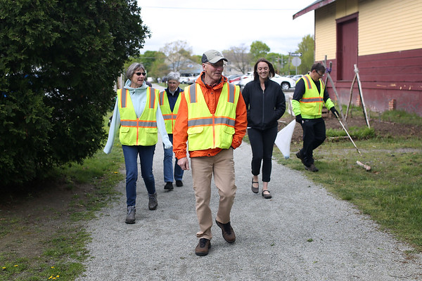 HADLEY GREEN/ Staff photo<br /> Paul McNulty, center, chairman of the Danvers rail trail advisory committee, walks along the rail trail with other community members involved with the project. 5/12/17