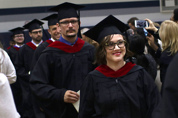 HADLEY GREEN/ Staff photo<br /> Allison Gerber walks into the Gordon-Conwell Theological Seminary graduation ceremony held at the Bennett Center at Gordon College in Wenham. 5/13/17