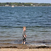 HADLEY GREEN/ Staff photo<br /> Connor Kaminski of Newton looks back at his mom while playing in the water at the Salem Willows. 5/16/17