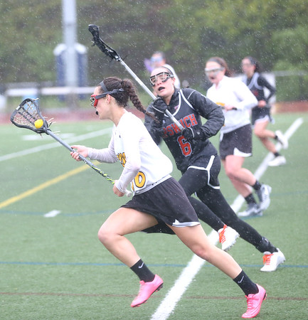 HADLEY GREEN/ Staff photo<br /> Bishop Fenwick's Ally Charette (16) drives the ball up the field while Ipswich's Grace Quinn (6) plays defense at the Bishop Fenwick v. Ipswich lacrosse game at Bishop Fenwick High. 5/5/17