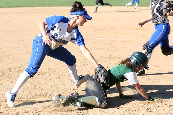 HADLEY GREEN/ Staff photo<br /> Danvers' Erica Haibon (15) tags Lynn's Emma DeJoie (7) out as she runs from home plate back to third base at the Danvers v. Lynn Classical High School girls softball game at the Great Oak School in Danvers. 5/10/17