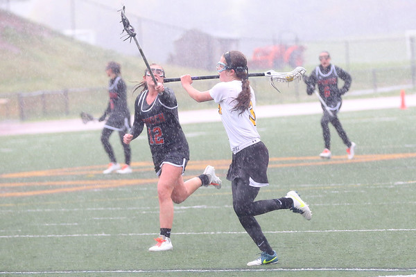 HADLEY GREEN/ Staff photo<br /> Ipswich's Meghan O'Connor (12) raises her stick to block Bishop Fenwick's Brigid Waldron (3) from passing the ball at the Bishop Fenwick v. Ipswich lacrosse game at Bishop Fenwick High. 5/5/17