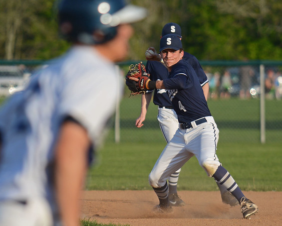 RYAN HUTTON/ Staff photo<br /> Swampscott's Matt Legere tries to beat the Danvers runner to first in the bottom of the first inning of Wednesday's game at Danvers.