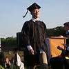 HADLEY GREEN/ Staff photo<br /> Graduating senior Qihang Tang walks across the stage to receive his diploma during the Bishop Fenwick High School graduation ceremony. 5/19/17