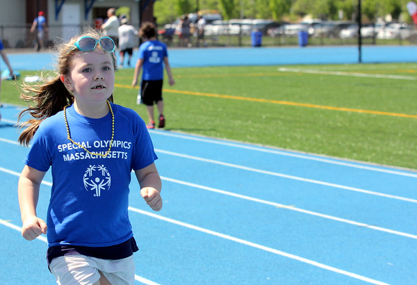 AMY SWEENEY/Staff photo.Logan Meeny, 6, from Cove Elementary School in Beverly practices her running during the Annual Special Olympics Danvers Day Games on Friday, May 19, at Danvers High School J. Ellison Morse Athletic Complex at Dr. Deering Stadium. The games are being held for all special needs children in the Danvers Public Schools grades K-12 and surrounding local communities.