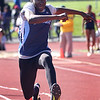HADLEY GREEN/ Staff photo<br /> Peabody's Jacob Hawthorne triple jumps at the NEC track championships at Peabody High School. 5/20/17
