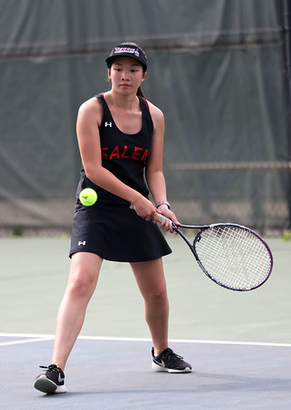 HADLEY GREEN/Staff photo<br /> Salem's Isabelle Santoro returns the ball during singles play against Marblehead's Sara Weiss at the Salem High School v. Marblehead High School girls tennis match at Salem State University. <br /> <br /> 05/17/2018