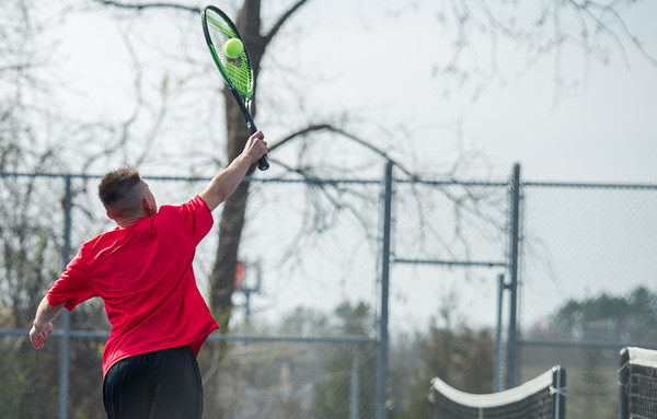 AMANDA SABGA/Staff photo<br /> <br /> Salem's Bao Ngo hits the ball during a tennis match between Peabody-Danvers and Salem at Peabody High School. <br /> <br /> 5/2/17