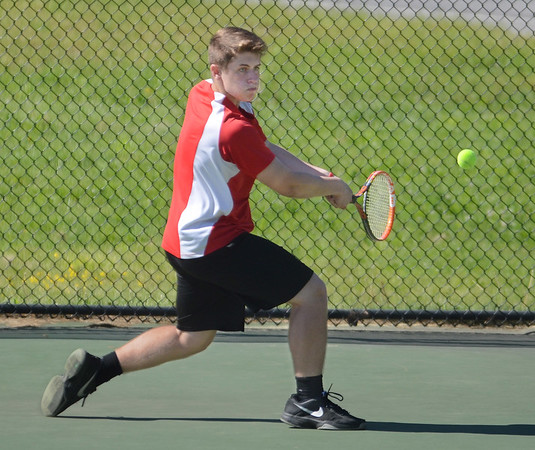MIKE SPRINGER/Staff photo<br /> Nick Walker of Masconomet prepares to hit a backhand Thursday against a Manchester Essex opponent in Manchester.<br /> 5/31/2018