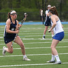 HADLEY GREEN/Staff photo<br /> Hamilton-Wenham's Annabel Howley (8) runs with the ball while Danvers' Jessica Barthelmess (14) defends her at the Danvers v. Hamilton-Wenham girls lacrosse game. <br /> <br /> 05/16/2018