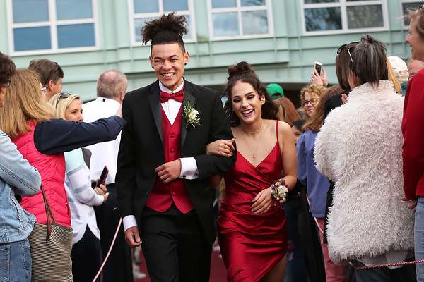 HADLEY GREEN/Staff photo Trevor Lipsett and Charlotte Farrar enter Marblehead High School's red carpet event for the junior prom.   05/18/2018