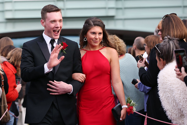 HADLEY GREEN/Staff photo Students wave to family and friends at Marblehead High School's red carpet event for the junior prom.   05/18/2018