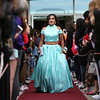 HADLEY GREEN/Staff photo<br /> Jailyn Hernandez walks down the red carpet before Marblehead High School's junior prom. <br /> <br /> 05/18/2018