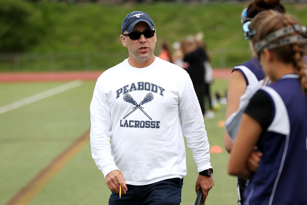 Staff photo/ HADLEY GREEN<br /> Peabody coach Dennis Desroches talks to players on the sideline at the Beverly v. Peabody girls lacrosse game.<br /> <br /> 05/28/2018
