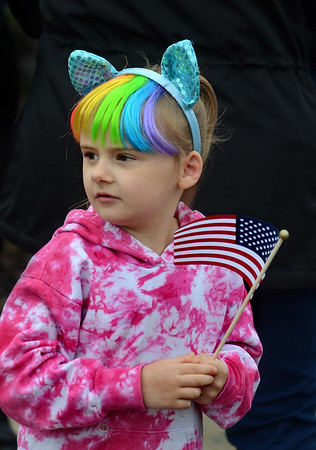 MIKE SPRINGER/Staff photo Five-year-old Alli D'Antonio watches the Memorial Day parade Monday in Danvers. 5/28/2018