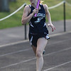 HADLEY GREEN/Staff photo<br /> Hamilton-Wenham's Charlotte Rubel competes in the girl's relay at the Hamilton-Wenham, Ipswich and Masconomet track meet at Hamilton-Wenham High School.<br /> <br /> 05/09/2018