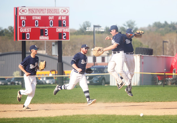 HADLEY GREEN/Staff photo<br /> Swampscott players celebrate after making an outfield play at the Masconomet v. Swampscott boys baseball game at Masconomet High School.<br /> <br /> 05/05/2018
