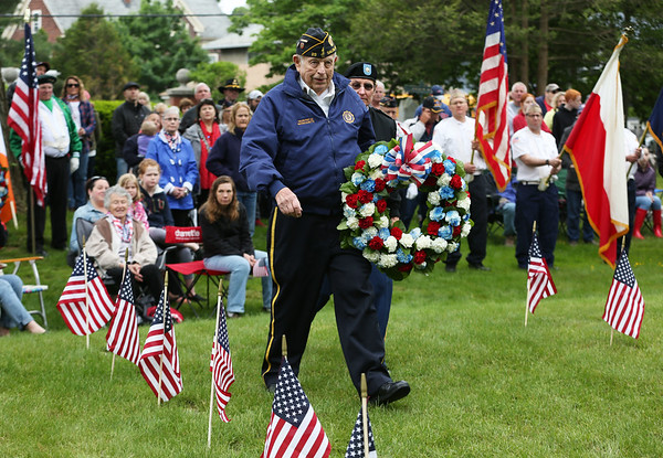 Staff photo/ HADLEY GREEN<br /> Douglas Sabin, a navy veteran who lives in Salem, places a wreath during the Salem Memorial Day ceremony at Greenlawn Cemetery. <br /> <br /> 05/28/2018