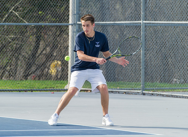 AMANDA SABGA/Staff photo<br /> <br /> Danvers' Kyle White returns the ball during a tennis match between Peabody-Danvers and Salem at Peabody High School. <br /> <br /> 5/2/17