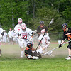 HADLEY GREEN/Staff photo<br /> Masconomet players race for the ball while Beverly's Chris Rosetti (21) is knocked to the ground at the Masconomet v. Beverly boys lacrosse game.<br /> <br /> 05/23/2018