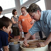 HADLEY GREEN/Staff photo<br /> Ellyn Robinson of Cynthia Curtis Pottery in Rockport demonstrates pottery-making while Cameron and William Shaw of Beverly watch.