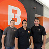 RYAN HUTTON/ Staff photo<br /> Best Fitness CEO David Dos Santos, center, stands with his partners Andy Marino, left, and Jor Dimare, right, outside the company's newest location at the Liberty Tree Mall in Danvers on Thursday.