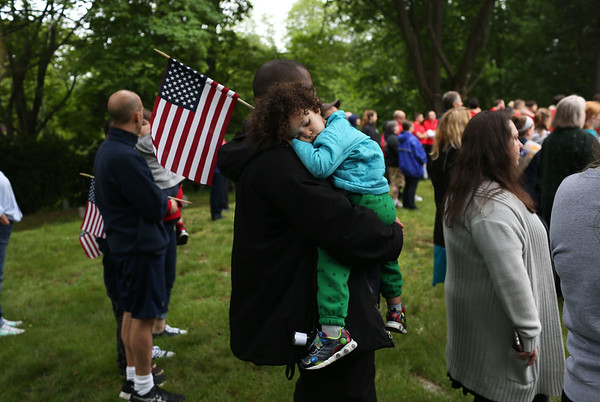 Staff photo/ HADLEY GREEN<br /> Mark Fields holds his son, Haven, during the Salem Memorial Day ceremony at Greenlawn Cemetery. <br /> 05/28/2018
