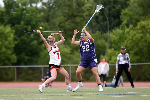 Staff photo/ HADLEY GREEN<br /> Beverly's Meghan Cotraro (7) and Peabody's Colleen Crotty (22) vie for the ball at the Beverly v. Peabody girls lacrosse game.<br /> <br /> 05/28/2018
