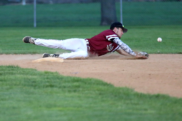 HADLEY GREEN/Staff photo<br /> Gloucester's Harry Marshall (21) dives for the ball at the Danvers v. Gloucester baseball game at Twi Field in Danvers.<br /> <br /> 05/11/2018