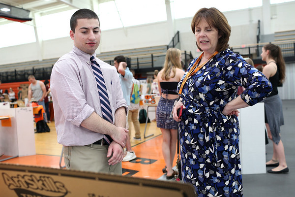Staff photo/ HADLEY GREEN<br /> Alexander Kleros speaks to Beverly High School principal Elizabeth Taylor about his research project on statistics in baseball during at the Beverly High School senior internship fair. <br /> <br /> 05/29/2018