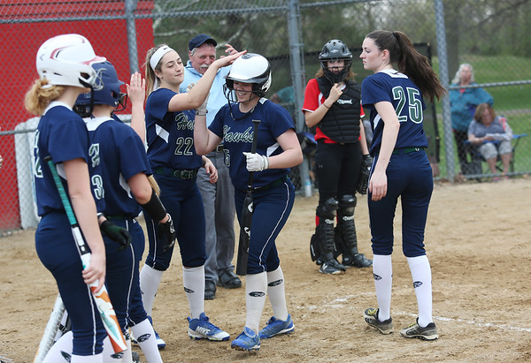 HADLEY GREEN/Staff photo<br /> Essex Tech players congratulate Hannah Lilly (5) after she hits a home run at the Salem v. Essex Tech softball game at Mack Park in Salem.<br /> <br /> 05/04/2018